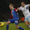 Crystal Palace's Barry Bannan, left, competes with West Ham United's Stewart Downing during their English Premier League soccer match at Selhurst Park, London, Tuesday, Dec. 3, 2013