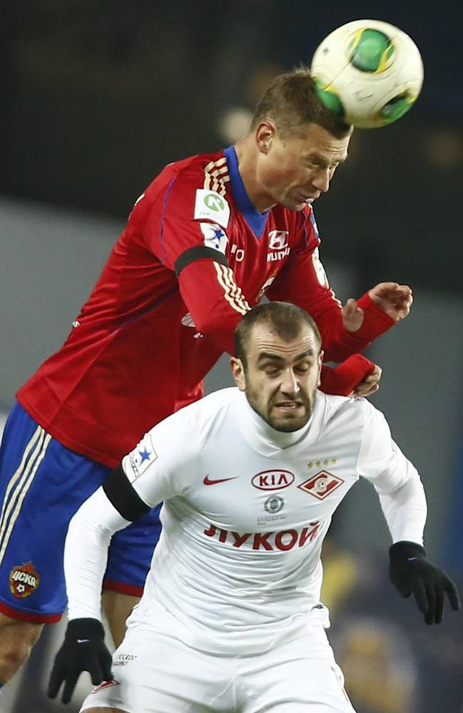 CSKA Moscow's Alexei Berezutski, left, fights for the ball with Spartak Moscow's Yura Movsisian during a Russian Premier League Championship soccer match between CSKA Moscow and Spartak Moscow at Arena Khimki stadium outside Moscow, Russia, Saturday, Nov. 23, 2013