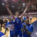Saint Louis' Rob Loe (51) celebrates after the team's 65-61 defeat of Butler in an the NCAA college basketball game Friday, Feb. 22, 2013, in Indianapolis. (AP Photo/Doug McSchooler)