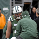 New York Jets center Nick Mangold (74) is carted off the field after being hurt during the first half of an NFL football game against the New England Patriots Sunday, Dec. 21, 2014, in East Rutherford, N.J. (AP Photo/Bill Kostroun)