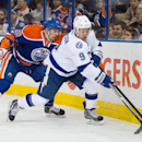 Tampa Bay Lightning forward Tyler Johnson (9) battles for the puck with Edmonton Oilers defenceman Justin Schultz (19) during first period NHL hockey action in Edmonton, Alberta, on Monday Oct. 20, 2014 The Associated Press