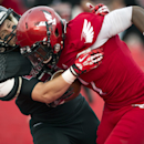 Montana Western defensive back Jay Owens (27) tackles Eastern Washington wide receiver Shaq Hill (1) during the first half of an NCAA college football game, Saturday, Aug. 30, 2014, in Cheney, Wash The Associated Press