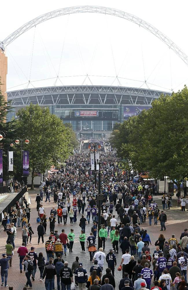 Supporters pack 'Wembley Way' as they arrive for the NFL football game between the Pittsburgh Steelers and the Minnesota Vikings at Wembley Stadium, London, Sunday, Sept. 29, 2013