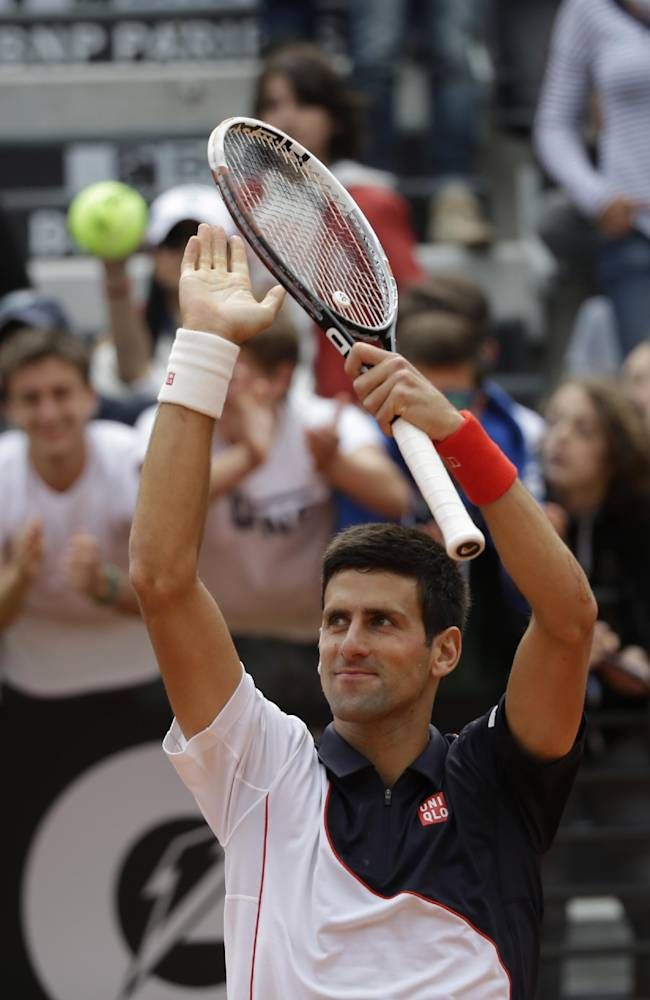 Novak Djokovic celebrates after beating Radek Stepanek at the Italian Open tennis tournament, in Rome, Tuesday, May 13, 2014. Djokovic won 6-3, 7-5