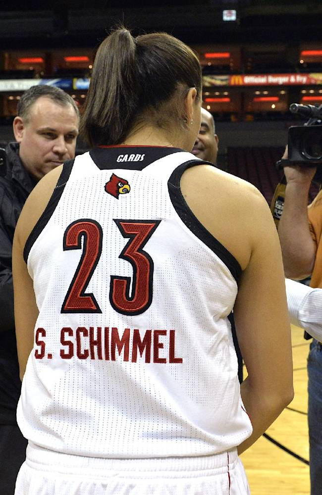 Louisville senior Shoni Schimmel, center, answers questions from reporters during NCAA college basketball media day Friday, Nov. 1, 2013, in Louisville, Ky