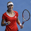 Ekaterina Makarova of Russia celebrates after defeating Simona Halep of Romania in their quarterfinal match at the Australian Open tennis championship in Melbourne, Australia, Tuesday, Jan. 27, 2015. (AP Photo/Lee Jin-man)