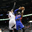 Detroit Pistons forward Greg Monroe (10) drives to the basket against Atlanta Hawks forward Paul Millsap (4) in the first period of an NBA basketball game in Atlanta, Tuesday, April 8, 2014. The Pistons won the game 102-95 The Associated Press