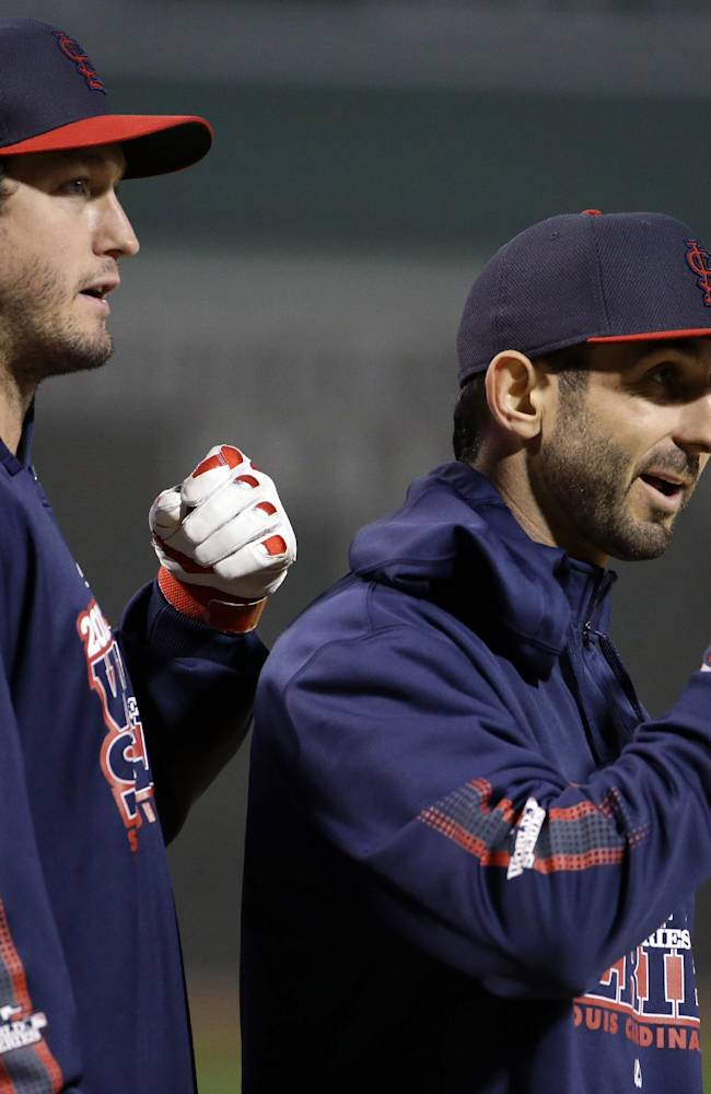 St. Louis Cardinals' David Freese, left, and Daniel Descalso talk during practice before Game 1 of baseball's World Series against the Boston Red Sox Wednesday, Oct. 23, 2013, in Boston