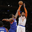 New York Knicks' Carmelo Anthony (7) shoots over Philadelphia 76ers' Thaddeus Young (21) during the first half of an NBA basketball game Monday, March 10, 2014, in New York The Associated Press