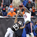 In this Dec. 15, 2013, file photo, Chicago Bears wide receiver Brandon Marshall (15) makes a catch against Cleveland Browns cornerback Joe Haden (23) during an NFL football game in Cleveland. During preseason games this year, NFL officials have been calli