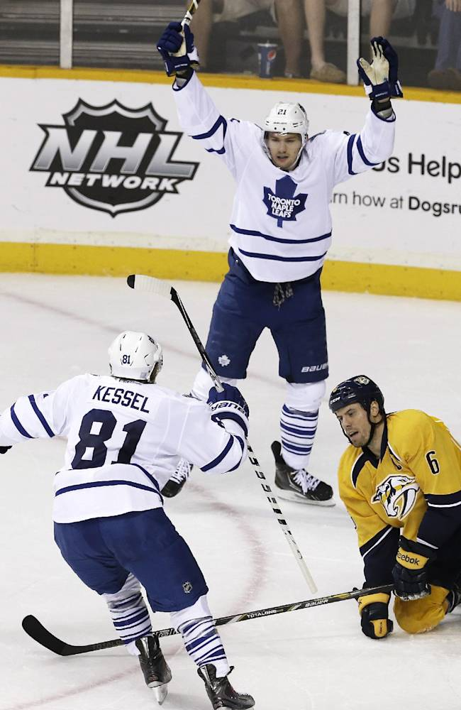 Toronto Maple Leafs left wing James van Riemsdyk (21) celebrates with Phil Kessel (81) as Nashville Predators defenseman Shea Weber (6) gets up off the ice after van Riemsdyk scored a goal in the second period of an NHL hockey game on Thursday, Oct. 10, 2013, in Nashville, Tenn