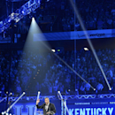 Kentucky men's basketball coach John Calipari speaks to the crowd gathered for the NCAA college basketball team's Big Blue Madness, Friday, Oct. 18, 2013, in Lexington, Ky.(AP Photo/Timothy D. Easley)