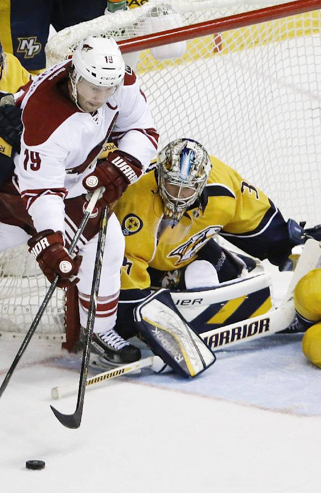 Phoenix Coyotes right wing Shane Doan (19) tries to get a shot away as he is defended by Nashville Predators defenseman Shea Weber (6), goalie Pekka Rinne (35), of Finland, and defenseman Roman Josi (59), of Switzerland, in the third period of an NHL hockey game on Thursday, April 10, 2014, in Nashville, Tenn. The Predators won 2-0