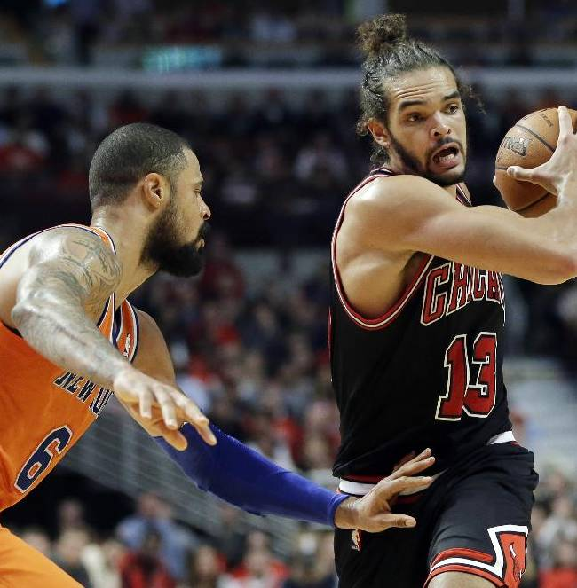 Chicago Bulls center Joakim Noah, right, looks to pass as New York Knicks center Tyson Chandler guards during the second half of an NBA basketball game in Chicago, Thursday, Oct. 31, 2013. The Bulls won 82-81