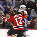 New Jersey Devils center Tim Sestito (12) checks New York Islanders defenseman Thomas Hickey during the second period of an NHL hockey game, Friday, Jan. 9, 2015, in Newark, N.J The Associated Press