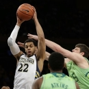 Marquette's Trent Lockett (22) rebounds the ball as Notre Dame's Tom Knight fights for control during the first half of an NCAA college basketball game at the Big East Conference tournament, Thursday, March 14, 2013, in New York. (AP Photo/Frank Franklin II)