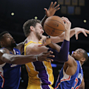 Los Angeles Lakers' Pau Gasol, center, of Spain, is defended by Los Angeles Clippers' DeAndre Jordan, left, and Willie Green during the first half of an NBA basketball game on Thursday, March 6, 2014, in Los Angeles The Associated Press