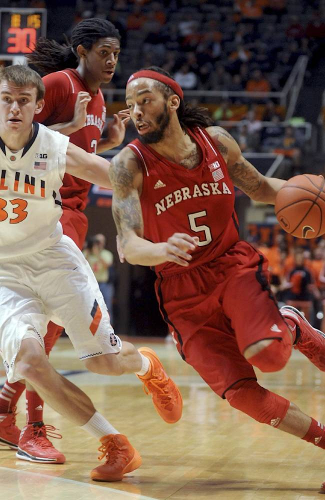 Nebraska's Terran Petteway (5) tries to dribble past Illinois' Jon Ekey (33) as Nebraska's David Rivers (2) watches during the second half of an NCAA college basketball game in Champaign, Ill., on Wednesday, Feb. 26, 2014. Illinois won 60-49