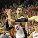 Bringham Youngs's Nate Austin (33) defends Gonzaga's Kelly Olynyk (13), in the second half of an NCAA college basketball game, Thursday, Jan. 24, 2013, in Spokane, Wash. Olynyk led the Gonzaga with 26 points. Gonzaga beat Bringham Young 83-63. (AP Photo/Jed Conklin)