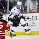 As New Jersey Devils' Eric Gelinas (22) looks on as San Jose Sharks' Patrick Marleau(12) celebrates his goal during the third period of an NHL hockey game, Sunday, March. 2, 2014, in Newark, N.J. Sharks won 4-2 The Associated Press