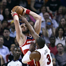 Miami Heat's Dwyane Wade (3) blocks a shot by Washington Wizards' Marcin Gortat (4) during the first half of an NBA basketball game in Miami, Monday, March 10, 2014 The Associated Press