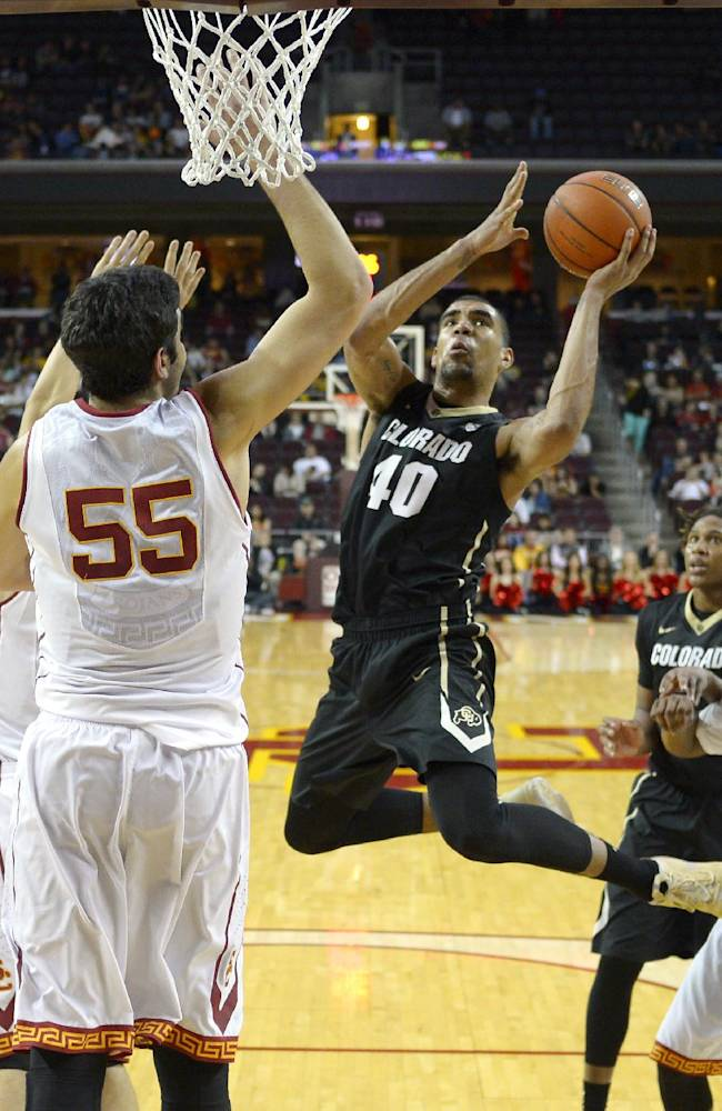 Colorado forward Josh Scott, right, puts up a shot as Southern California center Omar Oraby defends during the second half of an NCAA college basketball game, Sunday, Feb. 16, 2014, Los Angeles