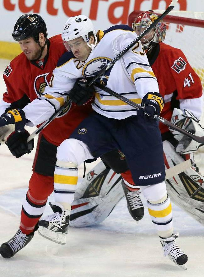 Ottawa Senators' Marc Mehot (3) ties up Buffalo Sabres' Ville Leino (23) in front of the Senators nets during the first period of an NHL hockey game, Thursday, Feb. 6, 2014 in Ottawa, Ontario