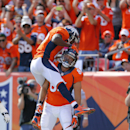 Denver Broncos tight end Jacob Tamme, bottom, celebrates his touchdown with Emmanuel Sanders during the first half of an NFL football game against the Kansas City Chiefs, Sunday, Sept. 14, 2014, in Denver The Associated Press