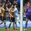 In this photo made available March 20 2014, Hull City's Georgre Boyd, centre left, is restrained by Martin Demichelis after a clash with Manchester City's goalkeeper Joe Hart, right, during their English Premier League soccer match at the KC Stadium, Hull