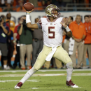 Florida State quarterback Jameis Winston (5) stands back to pass in the first half an NCAA college football game against Miami, Saturday, Nov. 15, 2014, in Miami Gardens, Fla. (AP Photo/Lynne Sladky)