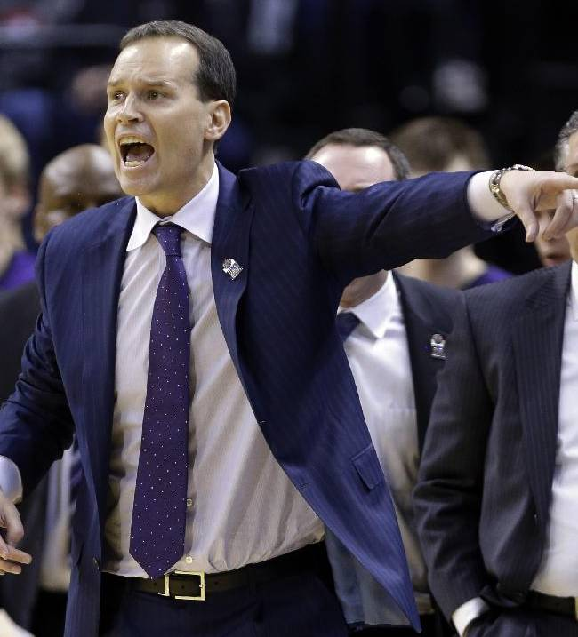 Northwestern head coach Chris Collins directs his team in the second half of an NCAA college basketball game against Iowa in the first round of the Big Ten Conference tournament, Thursday, March 13, 2014, in Indianapolis. Northwestern won 67-62