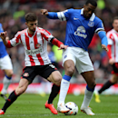 Sunderland's Fabio Borini, left, vies for the ball with Everton's Sylvain Distin, right, during their English Premier League soccer match at the Stadium of Light, Sunderland, England, Saturday, April 12, 2014