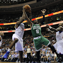 Philadelphia 76ers' Henry Sims (35) grabs a rebound over Boston Celtics' Rajon Rondo (9) during the second half of an NBA basketball game on Monday, April 14, 2014, in Philadelphia. The 76ers won 113-108 The Associated Press