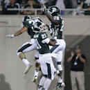 Michigan State cornerback Nick Tompkins (32) celebrates his interception against Jacksonville State with cornerback Justin Williams (21) and safety RJ Williamson (26) in the second half of an NCAA college football game in East Lansing, Mich., Friday, Aug. 29, 2014. (AP Photo/Paul Sancya)
