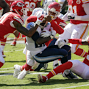 Tennessee Titans running back Leon Washington, center, is tackled by Kansas City Chiefs cornerback Sean Smith, left, safety Eric Berry, rear, and defensive back Husain Abdullah (39) in the first half of an NFL football game in Kansas City, Mo., Sunday, Se