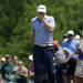 Keegan Bradley runs his hand across his face after missing a putt for birdie on the second green during the third round of the Byron Nelson Championship golf tournament Saturday, May 18, 2013, in Irving, Texas. (AP Photo/Tony Gutierrez)