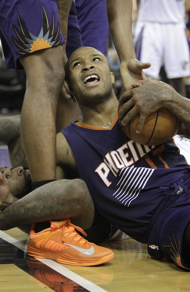 Phoenix Suns forward P.J. Tucker,right, tries to call timeout after battling Sacramento Kings center DeMarcus Cousins, left, for the ball during the fourth quarter of an NBA basketball game in Sacramento, Calif., Tuesday, Nov. 19, 2013.  The Kings won 107-104
