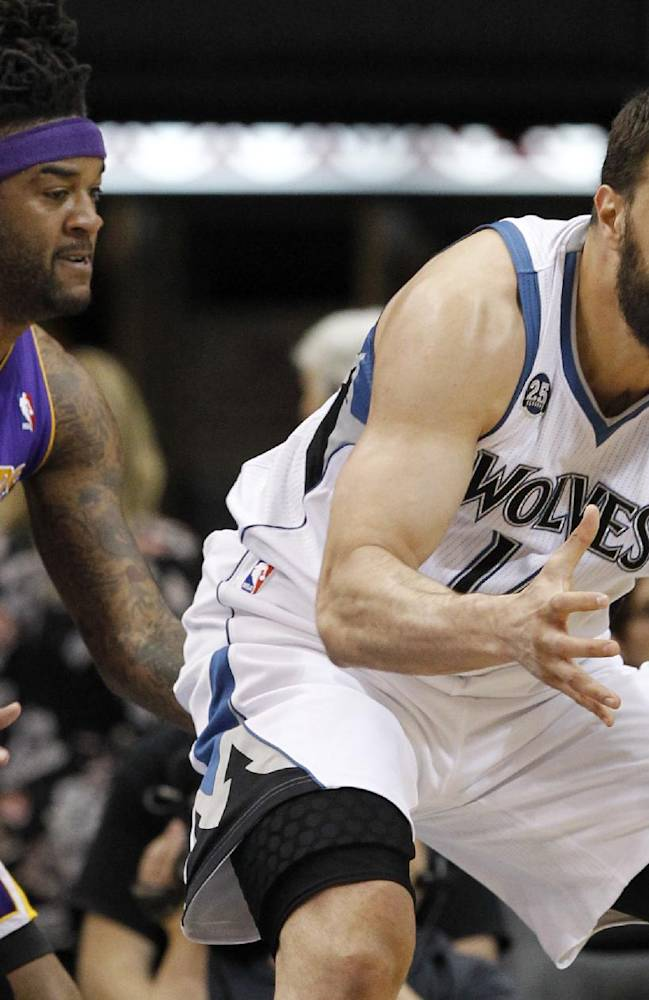 Minnesota Timberwolves center Nikola Pekovic, right, of Montenegro, regains control of the ball in front of Los Angeles Lakers forward Jordan Hill (27) during the second quarter of an NBA basketball game in Minneapolis, Friday, March 28, 2014
