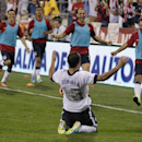 United States' Landon Donovan, front, celebrates his goal against Mexico during the second half of a World Cup qualifying soccer match Tuesday, Sept. 10, 2013, in Columbus, Ohio. The United States won 2-0. (AP Photo/Jay LaPrete)