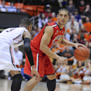 Arizona's Nick Johnson (13) works against Oregon State's Hallice Cooke (3) during the first half of an NCAA college basketball game in Corvallis, Ore., Wednesday March 5, 2014. (AP Photo/Greg Wahl-Stephens)