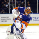 New York Islanders goalie Jaroslav Halak (41) clears the puck during the first period of an NHL hockey game against the Minnesota Wild on Tuesday, March 24, 2015, in Uniondale, N.Y. (AP Photo/Paul Bereswill)