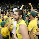 Oregon's Ben Carter, center, celebrates with teammates and fans on the court after the upset 64 57 win over Arizona in an NCAA college basketball game in Eugene, Ore. on Saturday, March 8, 2014. (AP Photo/Chris Pietsch)