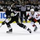 Pittsburgh Penguins' Evgeni Malkin (71) beats Ottawa Senators' Jean-Gabriel Pageau (44) to score a breakaway goal during the second period in Game 5 of the Eastern Conference semifinals in their NHL hockey Stanley Cup playoffs series on Friday, May 24, 2013, in Pittsburgh.(AP Photo/Gene J. Puskar)
