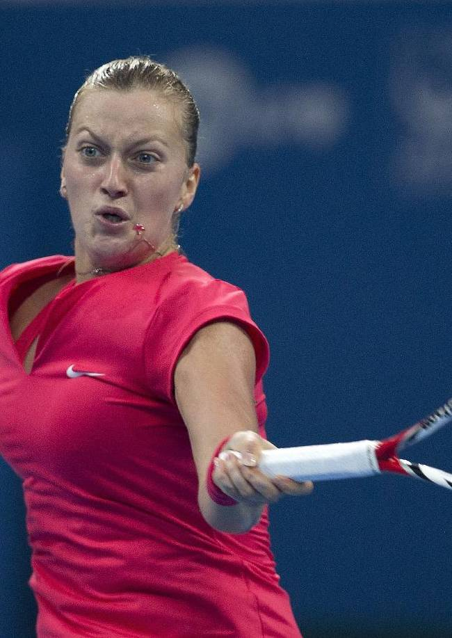 Petra Kvitova of the Czech Republic returns a shot to Li Na of China during the quarterfinal match of the China Open tennis tournament at the National Tennis Stadium in Beijing, China Friday, Oct. 4, 2013