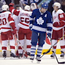 Toronto Maple Leafs left winger Joffrey Lupul skates off the ice as the Detroit Red Wings celebrate after their 4-2 win in NHL hockey game action in Toronto, Saturday, March 29, 2014 The Associated Press