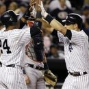New York Yankees' Robinson Cano (24) greets Mark Teixeira at the plate after Texieira hit a second-inning, solo home run off Boston Red Sox reliever Alfredo Aceves during their baseball game at Yankee Stadium in New York, Monday, Oct. 1, 2012. (AP Photo/Kathy Willens)