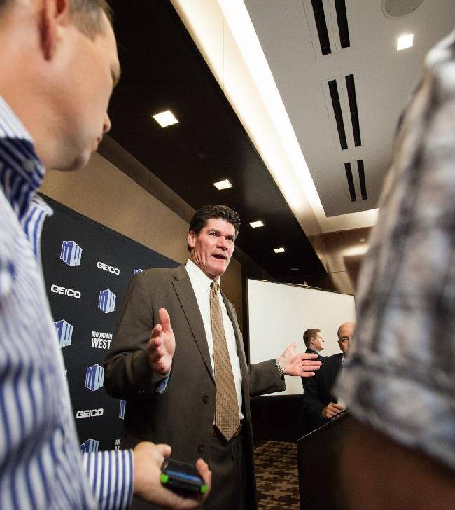 Mountain West Commissioner Craig Thompson speaks with reporters during the Mountain West Conference football media day at the Cosmopolitan hotel-casino Tuesday, July 22, 2014, in Las Vegas