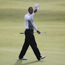 Tiger Woods of the U.S. acknowledges the crowd as he walks off the 18th green during the second round of the British Open golf championship on the Old Course in St. Andrews, Scotland, July 18, 2015.   REUTERS/Paul Childs