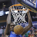 Dallas Mavericks' Samuel Dalembert dunks during the first quarter of an NBA basketball game against the Utah Jazz on Tuesday, April 8, 2014, in Salt Lake City The Associated Press