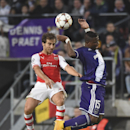Arsenal's Nacho Monreal, left, and Anderlecht's Gohi Bi Zoro Cyriac, jump to head the ball during the Group D Champions League match between Anderlecht and Arsenal at Constant Vanden Stock Stadium in Brussels, Belgium, Wednesday Oct. 22, 2014